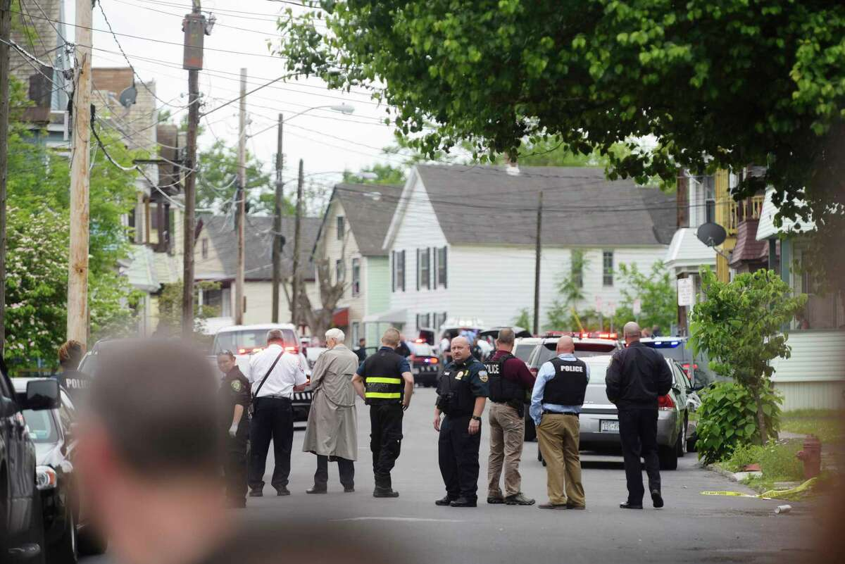 Police and rescue personnel work at the scene where police shot a man on Monday, June 5, 2017, in Schenectady, N.Y. (Paul Buckowski / Times Union)