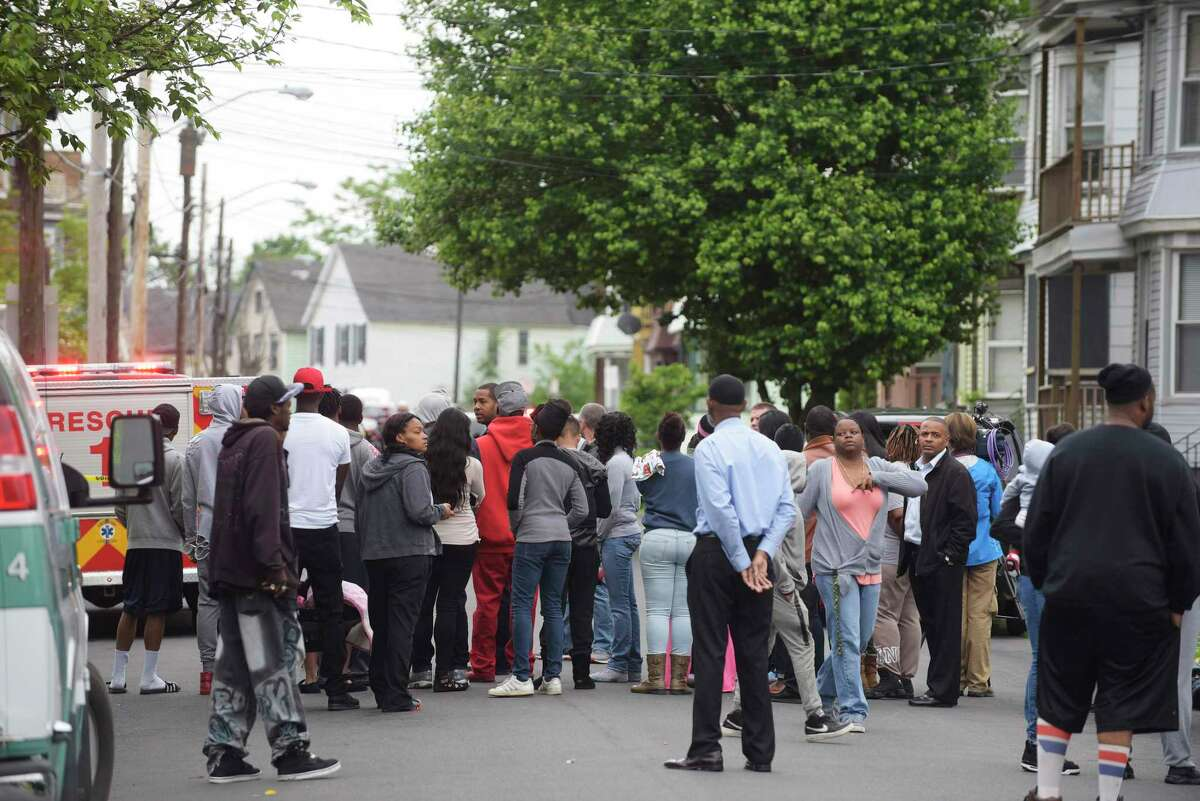 People gather on Mumford Street near an area where a man was shot by police earlier on Monday, June 5, 2017, in Schenectady, N.Y. (Paul Buckowski / Times Union)