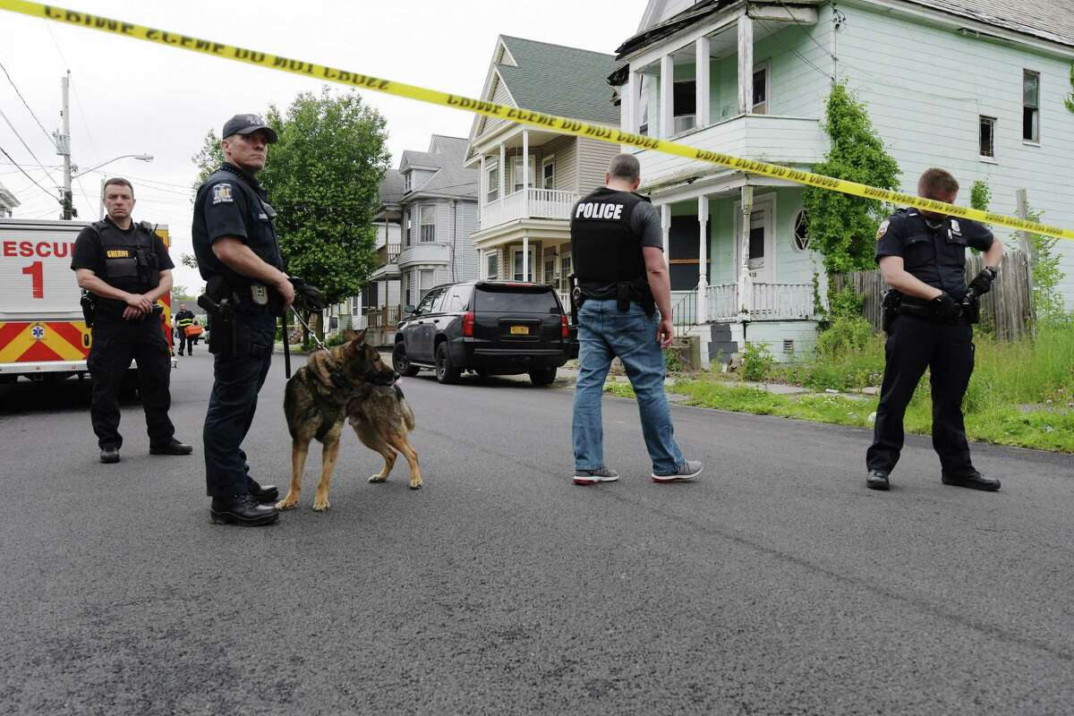 Law enforcement officers on Mumford Street near the scene where a man was shot by police on Monday, June 5, 2017, in Schenectady, N.Y. (Paul Buckowski / Times Union)