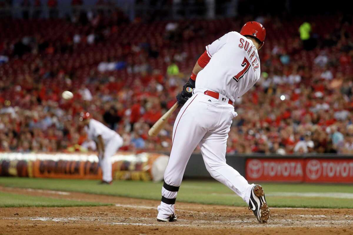 Cincinnati Reds' Eugenio Suarez hits a game-tying two-run double off St. Louis Cardinals starting pitcher Carlos Martinez in the seventh inning of a baseball game, Monday, June 5, 2017, in Cincinnati. (AP Photo/John Minchillo) tie ORG XMIT: OHJM110