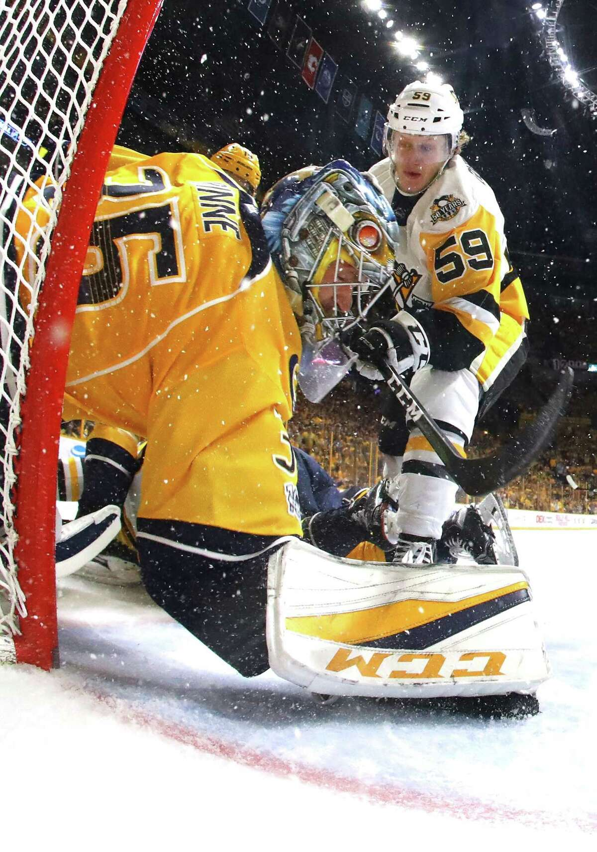 NASHVILLE, TN - JUNE 05: Pekka Rinne #35 of the Nashville Predators makes a glove save against Jake Guentzel #59 of the Pittsburgh Penguins during the second period in Game Four of the 2017 NHL Stanley Cup Final at the Bridgestone Arena on June 5, 2017 in Nashville, Tennessee. (Photo by Bruce Bennett/Getty Images) ORG XMIT: 700056236