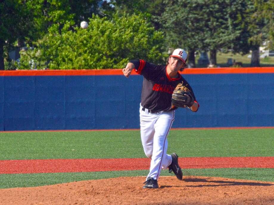 Edwardsville senior Kade Burns fires home a pitch in the third inning.