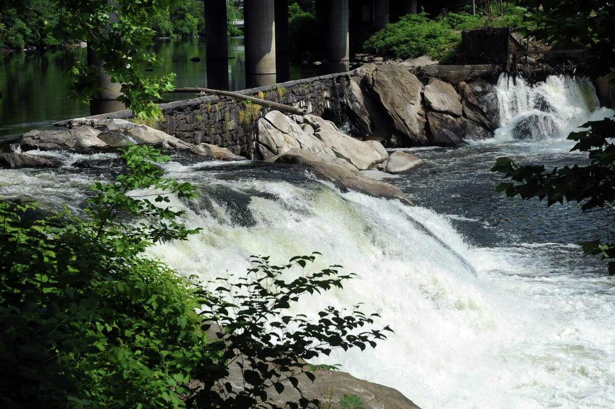 The Tingue Dam in Seymour, Conn. is the site of a $5 million dollar fish by-pass ladder which will be installed by CT DEEP. Crews have fenced off part of the Wakeley Street parking lot in downtown Seymour to begin the project.