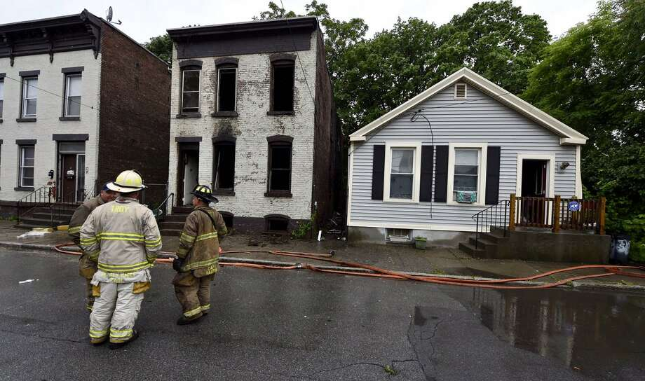 A fire gutted a vacant home at 38 Ida St., and spread to a neighboring building where people lived, city officials said. The residents of the neighboring home escaped without harm, but fire officials said one firefighters suffered a minor injury. Photo: Skip Dickstein / Times Union