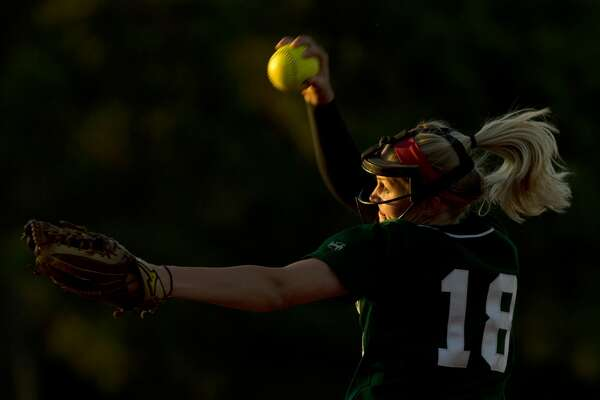 The Woodlands pitcher Emily Langkamp (18) throws during the second inning of a District 12-6A high school softball game Friday, April 7, 2017, in The Woodlands.
