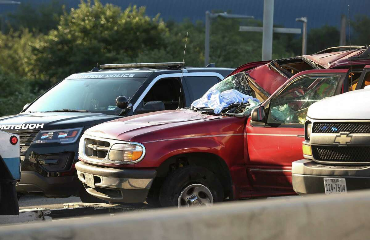 Houston Police investigated the scene where a loose tire struck a red SUV and killed the driver on the northbound lanes of Gulf Freeway near Pierce Street Tuesday, June 6, 2017, in Houston.