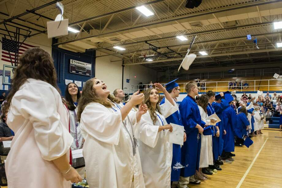 Coleman graduates, including Amrita Wirk, Alexis O'Connor, Xavioer Snear and Tabetha Goodwin throw their caps in the air during the graduation ceremony at Coleman High School on Sunday. Photo: Danielle McGrew Tenbusch