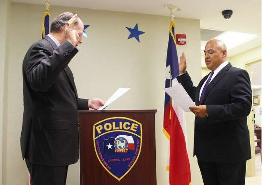 Police Chief Ray Garner sworn in Pete Arredondo as captain for the United ISD Police Department on Monday.  Photo: Laredo Morning Times