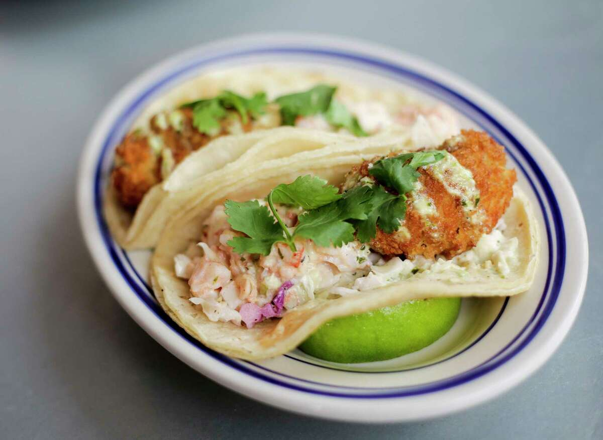Liberty Kitchen Garden Oaks patio menu offers grilled crab ball and shrimp Louis tacos.