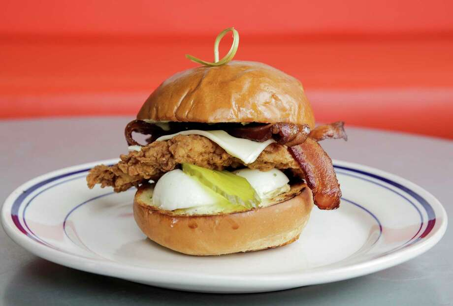 "The BLT-Better Grilled Chicken Sandwich done  ""Denverado Style"" (with fried chicken, bacon, smashed deviled egg, pickles and green garlic ranch) at Liberty Kitchen Garden Oaks. Photo: Elizabeth Conley, Houston Chronicle / © 2017 Houston Chronicle"