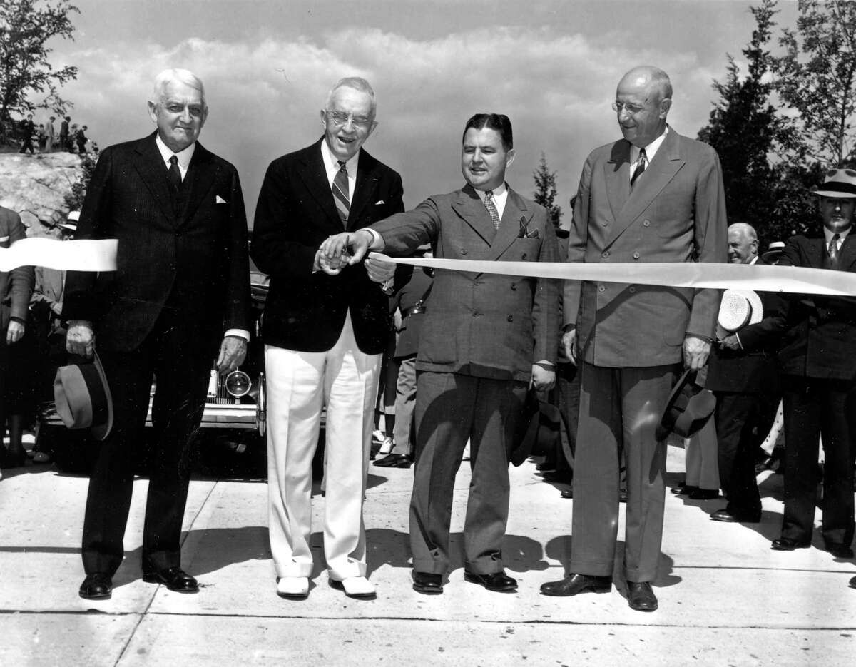 In early summer of 1938, Former Congressman Schuyler Merritt of Stamford, in the white pants, was on hand to assist Greenwich First Selectman Eugene S. Loughlin, to his right, at the ribbon-cutting ceremony to open the Merritt Parkway in Greenwich.