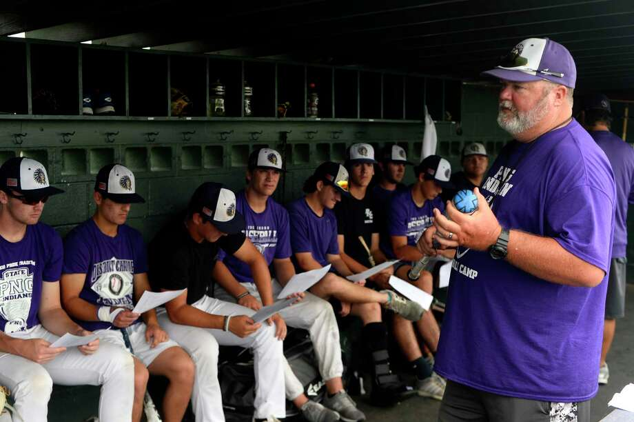 Port Neches-Groves baseball coach Scott Carter talks to the team during practice on Monday. The team will play in the state semi-finals on Thursday.  Photo taken Monday 6/5/17 Ryan Pelham/The Enterprise Photo: Ryan Pelham / ©2017 The Beaumont Enterprise/Ryan Pelham