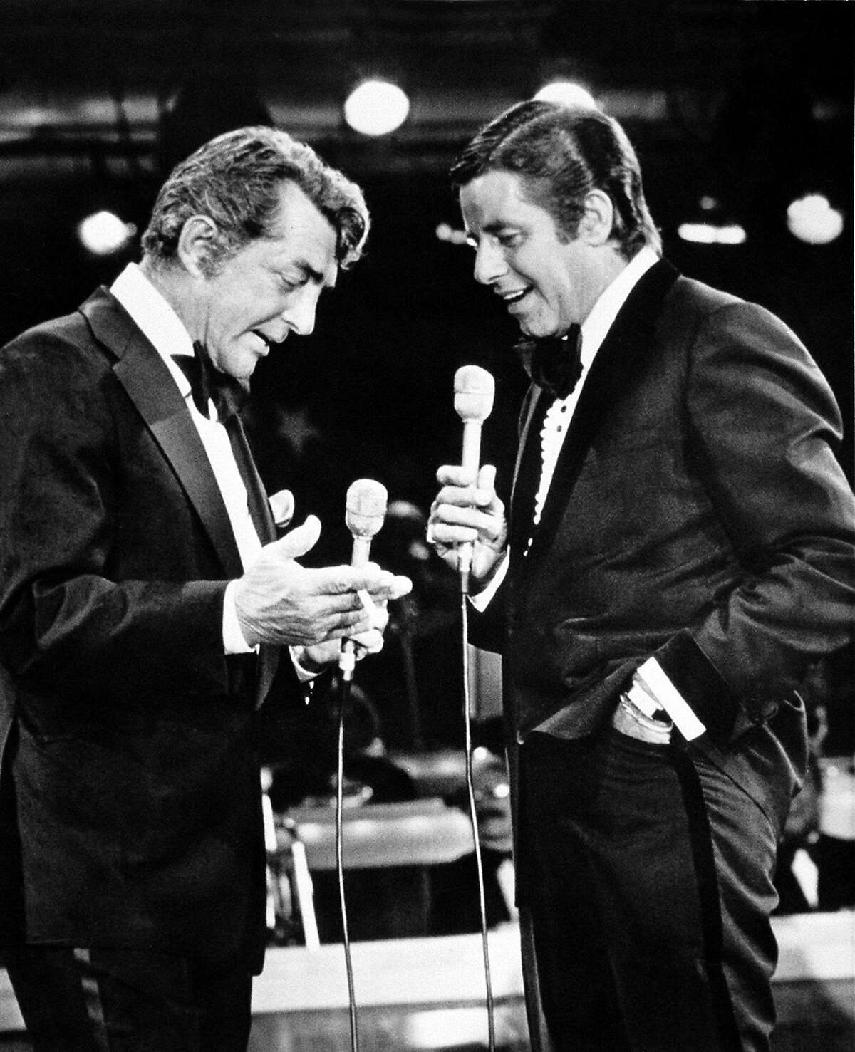 In this Sept. 7, 1976 file photo, entertainers Dean Martin, left, and Jerry Lewis appear together on Lewis's annual telethon for the Muscular Dystrophy Association in Las Vegas, NV.