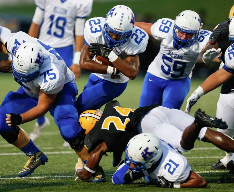 Klein running back D'Anthony Simms (23) is hit at the line by Fort Bend Marshall linebacker Adrion Robertson (24) during the second quarter of a non-district high school football game at Hall Stadium on Thursday, Sept. 8, 2016, in Missouri City. ( Brett Coomer / Houston Chronicle ) Photo: Brett Coomer, Staff / © 2016 Houston Chronicle