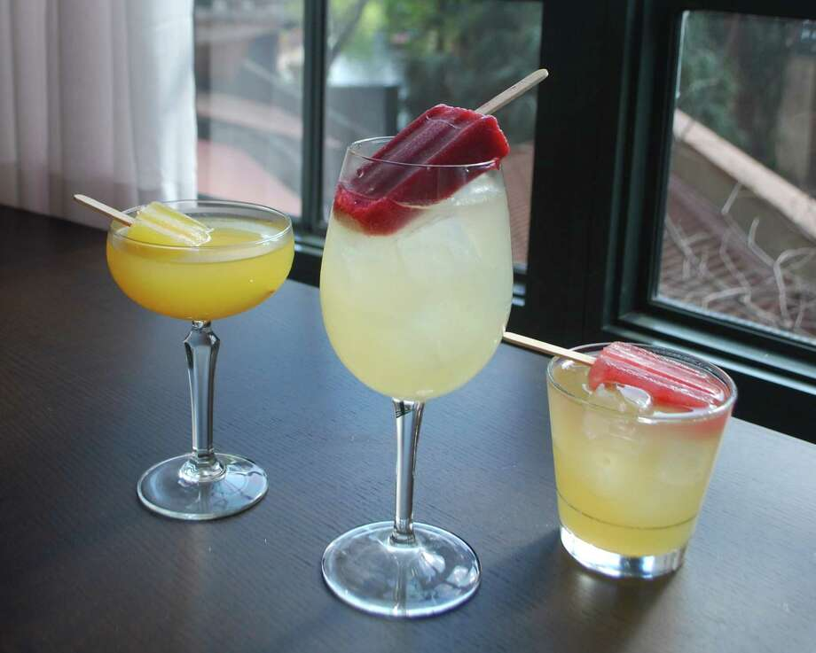 The Hotel Valencia Riverwalk's two bars, Dorrego's and Naranja, will be serving up three specialty poptails all summer long, through Sept. 15. From left: Blood Orange-Mango, Watermelon Mint Margarita and Orange Habanero Cooler. Photo: Courtesy Photo