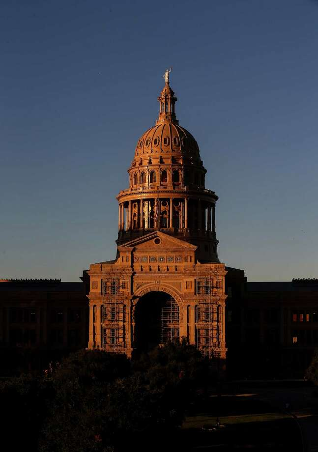 """The sun sets over the Texas Capitol Friday, Oct. 21, 2016, in Austin. The House approved on second reading a """"sunset"""" bill that would extend operations for five agencies that oversee medical personnel until 2019. ( Jon Shapley / Houston Chronicle ) Photo: Jon Shapley, Staff / Stratford Booster Club"""