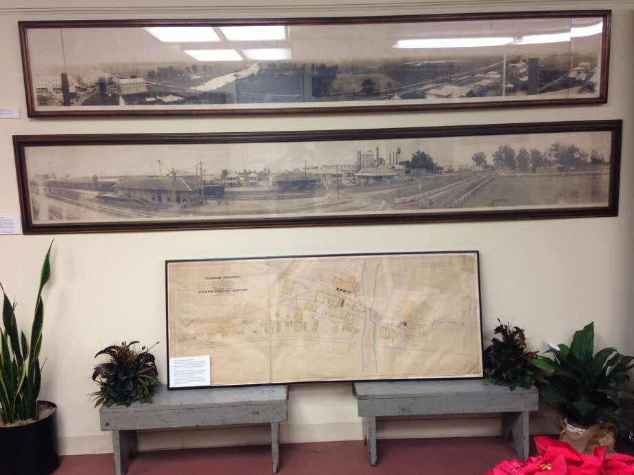 The Sugar Land Heritage Foundation will work to restore some artifacts of the city's history, including these old panorama photos and a circa-1920 site map of the Imperial sugar refinery. Photo: Courtesy
