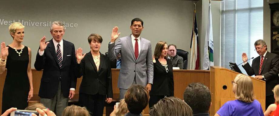 From left to right, West University Place City Council members Kellye Burke, Bob Higley, Mardi Turner and Wayne Franklin, and Mayor Susan Sample are sworn in by Harris County Judge and West U resident Ed Emmett. Photo: Jaimy Jones / HCN Staff