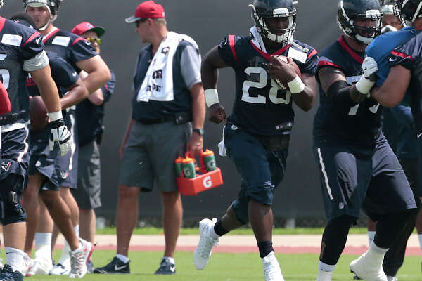 Houston Texans running back Alfred Blue (28) runs with the ball during OTAs at The Methodist Training Center on Tuesday, June 6, 2017, in Houston.