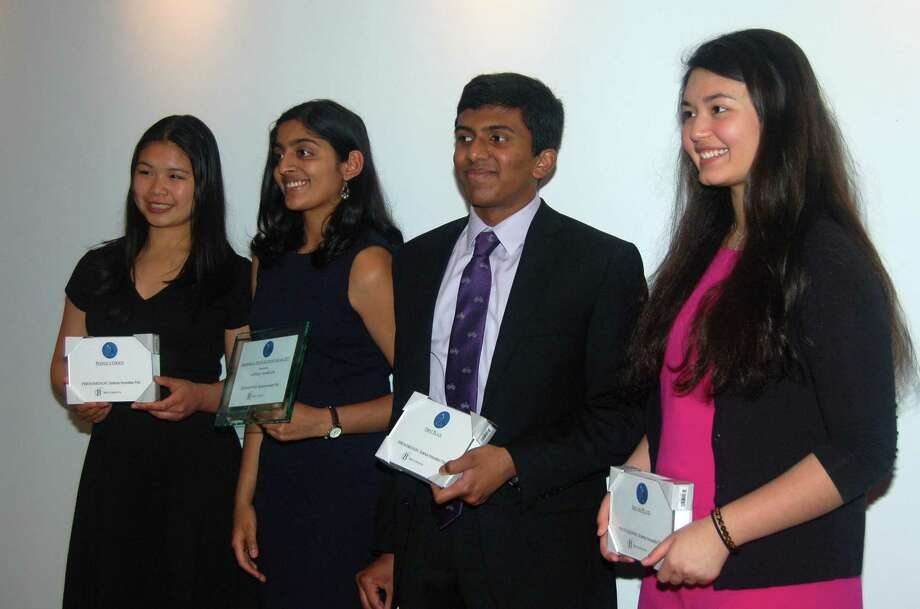 Bruce Museum's 3rd Annual Phenomenon: Science Innovation Fair (left to right): Michelle Woo, People's Choice Award Winner; Shobhita Sundaram, Phenomenal Young Scientist; Rahul Subramaniam, First Prize Winner; Dante Minichetti, Second Place Winner. Photo: Cynthia Ehlinger Bruce Museum / Contributed Photo