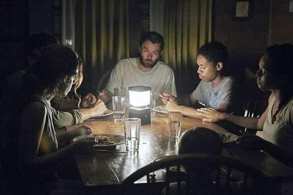 "(L-r) Riley Keough, Christopher Abbott, Joel Edgerton, Kelvin Harrison Jr., Carmen Ejogo and Griffin Robert Faulkner in ""It Comes at Night."" MUST CREDIT: Eric McNatt, A24"