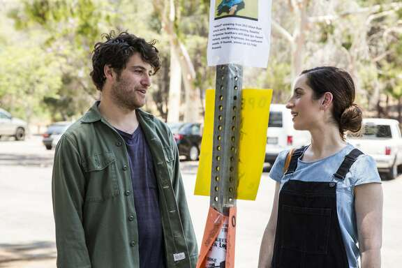 "Adam Pally and Zoe Lister-Jones in ""Band Aid."""