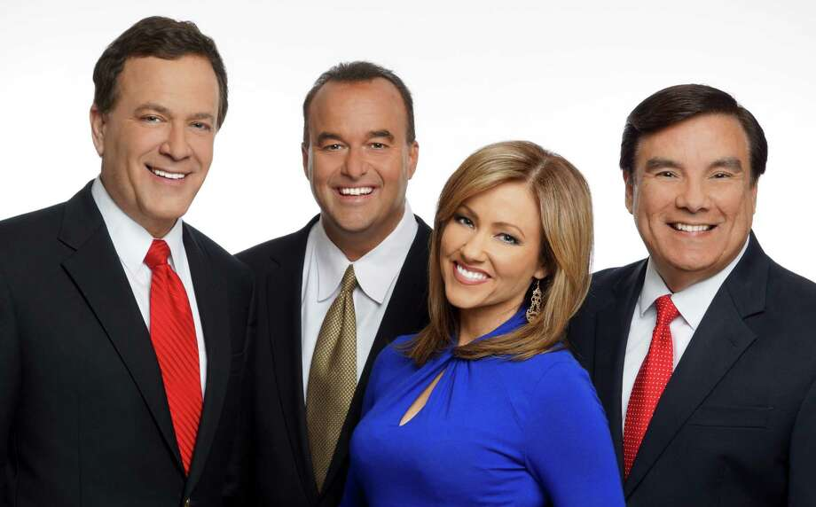 WOAI-TV's chief meteorologist Albert Flores, far right, said he's leaving the television weather business, effective immediately. He's seen here with his team, anchor Randy Beamer, sportscaster Don Harris and anchor Delaine Mathieu. Photo: WOAI