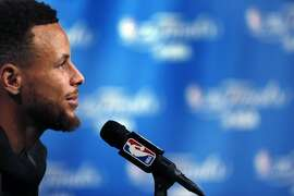 Stephen Curry (30) talks to reporters during an off-day practice before the Golden State Warriors played the Cleveland Cavaliers in Game 3 of the NBA Finals at Oracle Arena in Oakland, Calif., on Tuesday, June 6, 2017.