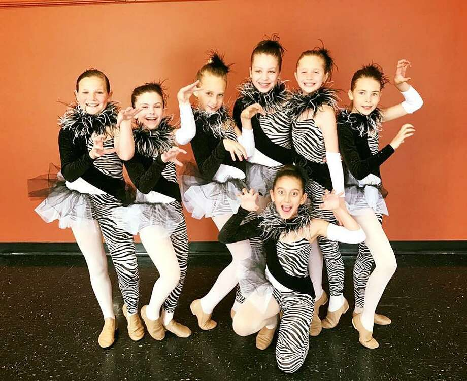 Darien residents Ellery Overbeck, left, Katie Cutler, Caleigh Cummiskey, Mackenzie Nolan, Janelle Mascis, Matilde Ayerza and Juliana Bambina pretended to be African zebras during the Darien School of Dance's performance at Darien High School on May 21. Photo: Contributed / Contributed Photo