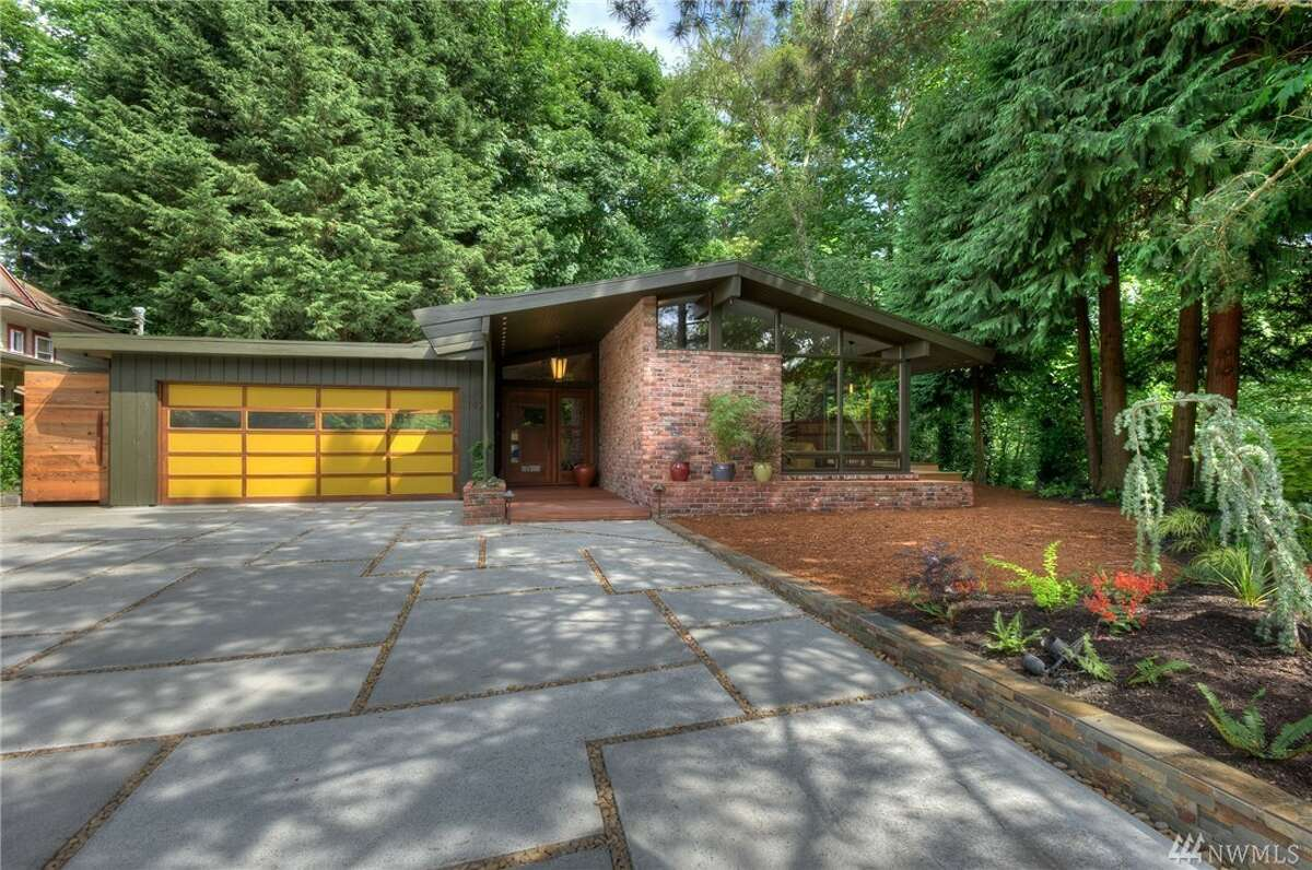 """This custom, 1957 mid-century modern in Maple Leaf is some classic neo-Northwest architecture. Plus, it comes with an outdoor sauna and """"infinity deck"""" made of Brazilian walnut, as well as about one-third of an acre of urban green space. It's at 1421 N.E. 106th St., listed for $744,388. See the full listing here."""