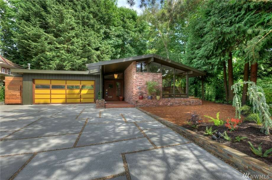 "This custom, 1957 mid-century modern in Maple Leaf is some classic neo-Northwest architecture. Plus, it comes with an outdoor sauna and ""infinity deck"" made of Brazilian walnut, as well as about one-third of an acre of urban green space.It's at 1421 N.E. 106th St., listed for $744,388. See the full listing here. Photo: William Feemster/Image Arts Photography"