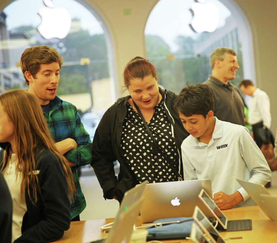 Whitby Upper School Math Teacher Joseph Budzelek, Primary Years Programme Coordinator Diana Ljepoja and sixth grader Aveer Pandey participated in a science expo at the Greenwich Apple Store Tuesday. Photo: Contributed