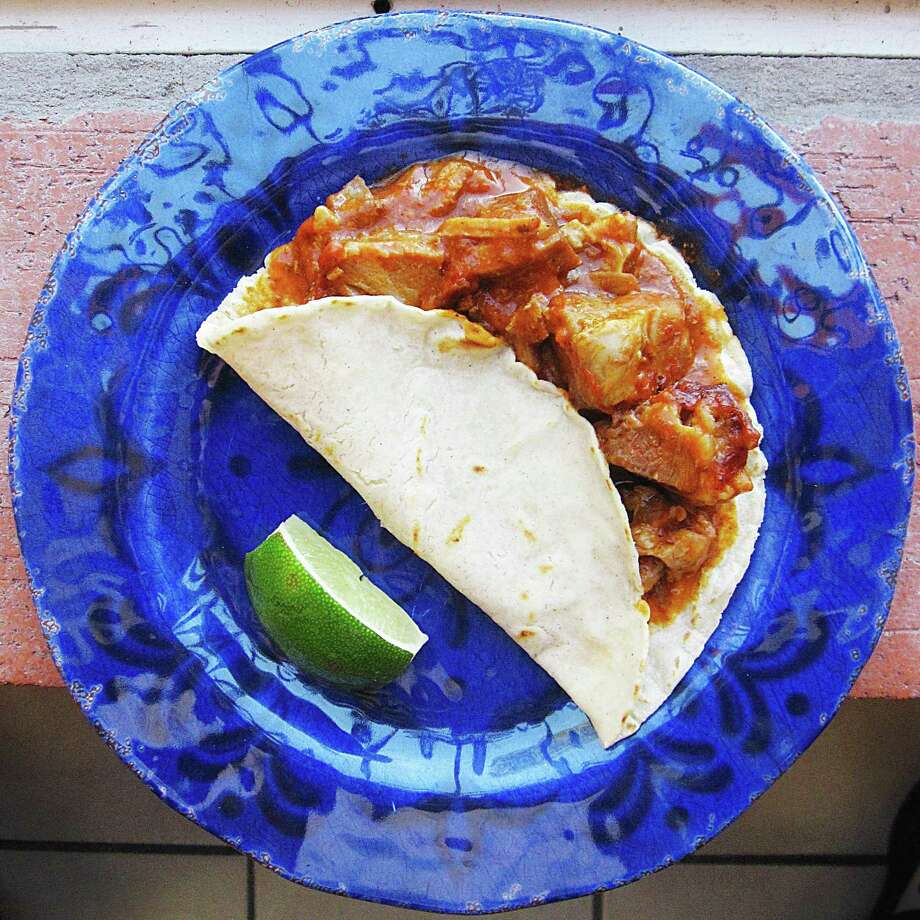 Puerco en chile cascabel taco on a handmade corn tortilla from Los Magueyes Mexican Restaurant. Photo: Mike Sutter /San Antonio Express-News