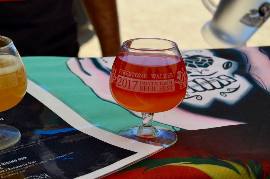 A Firestone Walker Invitational Beer Festival tasting glass containing a sampling of Garage Project's two-tone Yuzu Rising Sun in Paso Robles, Calif. on June 3, 2017. Photo: Courtesy Niko Christensen For SFGATE