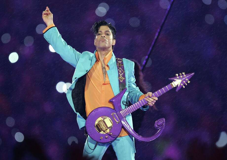 Pop star Prince performs during the halftime show at Super Bowl XLI in Miami in 2007. Before his abrupt death a year ago, the pop musician made an investment in green energy that's now helping several solar start-ups. Photo: Associated Press File Photo / Copyright 2017 The Associated Press. All rights reserved.