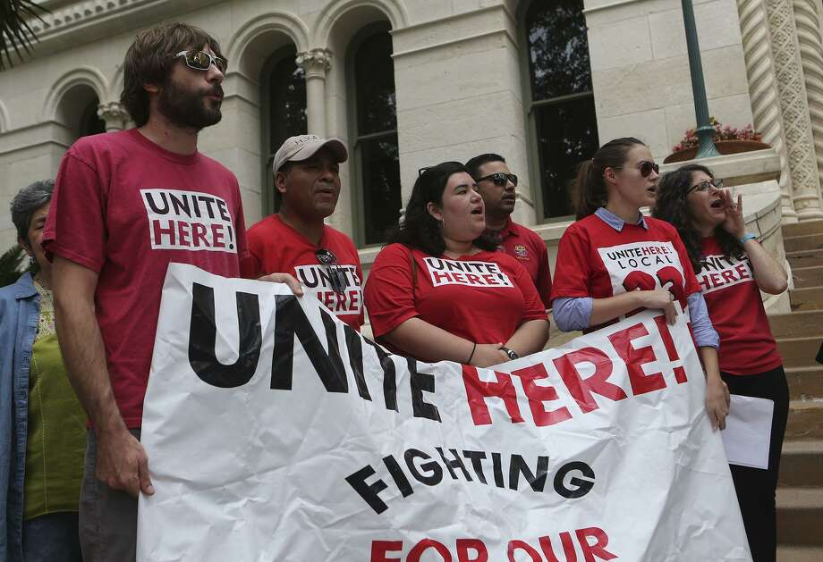 Supporters of Unite Here! chant Thursday during an announcement made in front of City Hall regarding a lawsuit over Senate Bill 4. SB 4 allows police officers to question a persons immigration status during a detainment. Photo: John Davenport /San Antonio Express-News / ©John Davenport/San Antonio Express-News