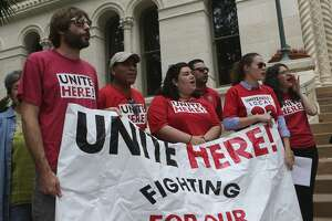 Supporters of Unite Here! chant Thursday during an announcement made in front of City Hall regarding a lawsuit over Senate Bill 4. SB 4 allows police officers to question a persons immigration status during a detainment.