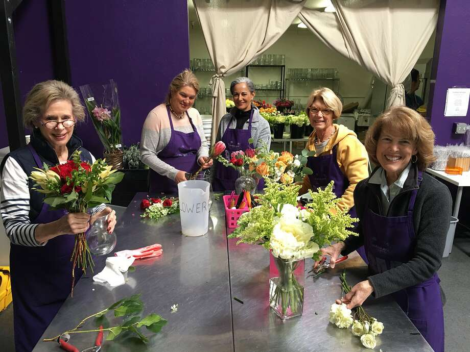 Volunteers for Random Acts of Flowers in Menlo Park make arrangements of flowers to donate. Photo: Random Acts Of Flowers