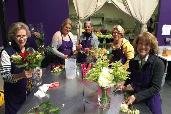 Volunteers make arrangements to donate.  Credit: Random Acts of Flowers