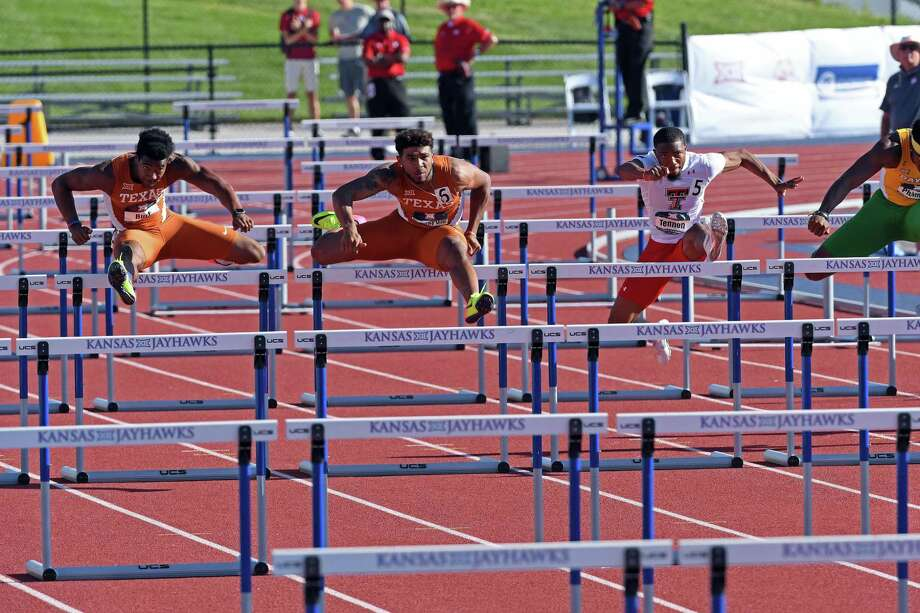 Texas wide receiver John Burt (left) runs the 110-meter hurdles at the 2017 Big 12 Track & Field Championships. Photo: Courtesy Photo /Big 12 Conference / Big 12 Conference