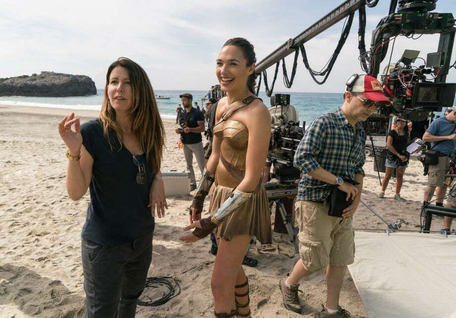 "Patty Jenkins, left, directs Gal Gadot in ""Wonder Woman."" The film is expected to make history as the first female-fronted superhero blockbuster and a rare big-budget picture directed by a woman. Photo: Warner Bros. / DC Entertainment / Warner Bros.- DC Entertainment"