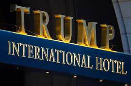 (FILES) This file photo taken on March 23, 2017 shows the sign on the Trump International Hotel in Washington,DC.   The Trump Organization, which for years focused on high-end, luxury real estate, on June 6, 2017 announced a new foray into the domestic hotel market with a chain of middle-of-the-range hotels. The venture was inspired by travels by the Trump children on father Donald Trump's presidential election campaign last year, when they were introduced to lackluster hotels in the US hinterland, The New York Times reported.The new line will be called American Idea and three agreements have been signed for properties in the Mississippi Delta area, announced Trump Hotels, which is part of The Trump Organization.  / AFP PHOTO / PAUL J. RICHARDSPAUL J. RICHARDS/AFP/Getty Images