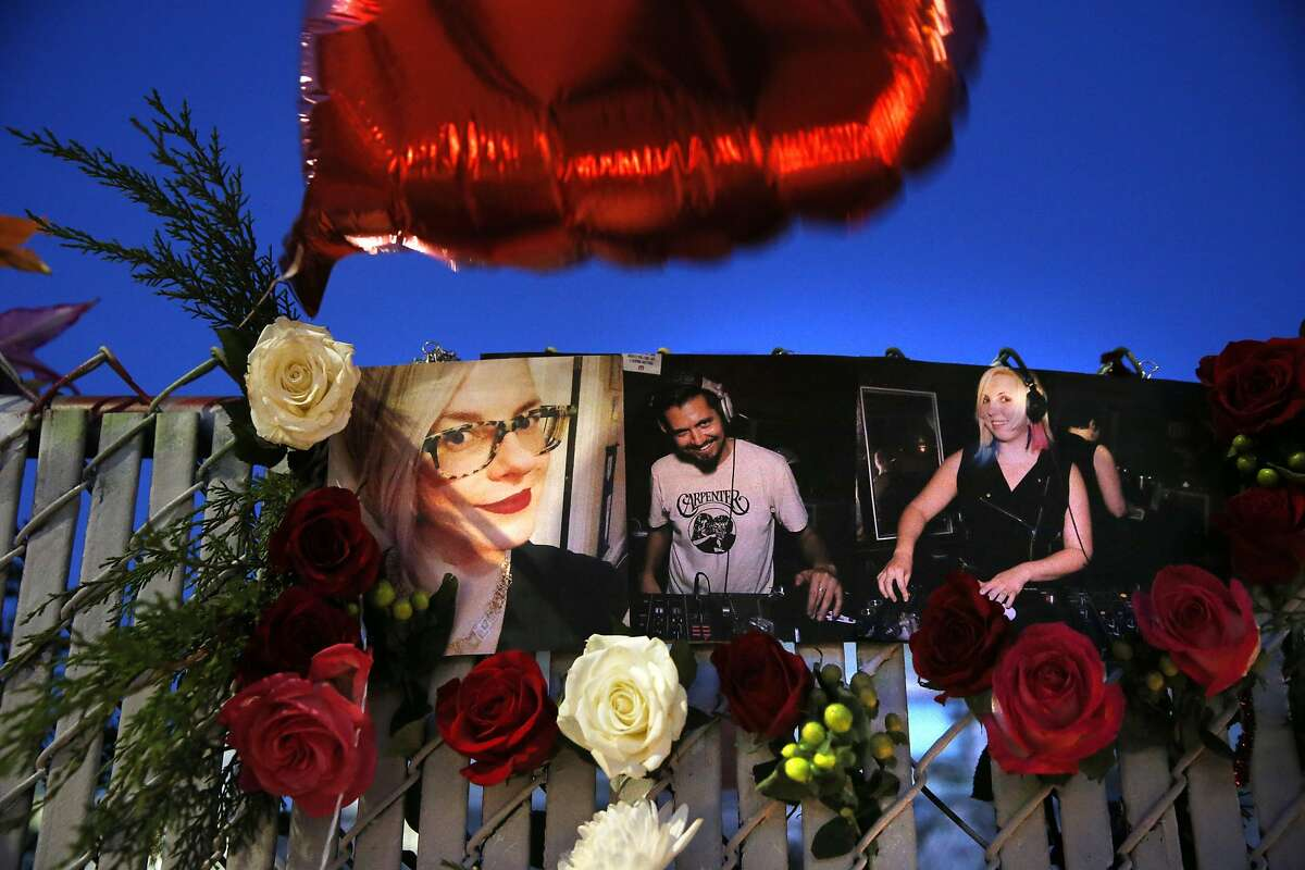 Photos of several victims are displayed as part of a memorial on E. 12th Street as recovery efforts came to a close following the Ghost Ship fire that claimed 36 lives in Oakland, Calif., on Tuesday, December 6, 2016.