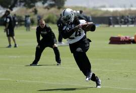 Oakland Raiders running back Marshawn Lynch runs after a catch during the team's organized team activity at its NFL football training facility Tuesday, June 6, 2017, in Alameda, Calif. (AP Photo/Marcio Jose Sanchez)