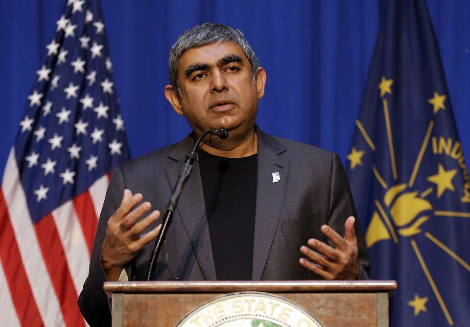 "Vishal Sikka, CEO of Infosys, announces plans to increase his company's operations in the U.S, establishing four new state-of-the-art technology and innovation hubs in the U.S., with the first one in Indiana. He made the announcement at the Statehouse in Indianapolis in May 2017. Sikka said in April that the company will expand its local hiring to ""mitigate any potential risks from visa regulations in the U.S."" Photo: Michael Conroy, Associated Press"