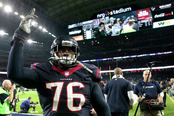 Houston Texans tackle Duane Brown (76) waves to the fans as he leaves the field after the Texans 27-14 win over the Oakland Raiders in an AFC Wild Card Playoff game at NRG Stadium on Saturday, Jan. 7, 2017, in Houston. ( Brett Coomer / Houston Chronicle )