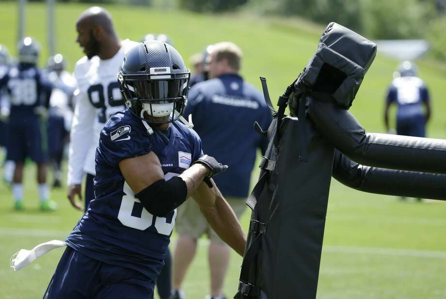 Seattle Seahawks wide receiver Doug Baldwin (89) hits a blocking dummy as he takes part in a drill with defensive tackles during NFL football practice, Tuesday, June 6, 2017, in Renton, Wash. (AP Photo/Ted S. Warren) Photo: Ted S. Warren/AP