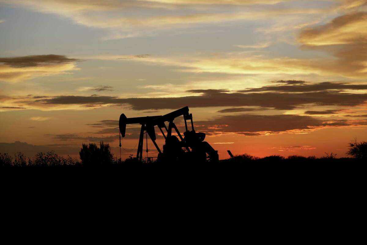Pumpjacks work in an oil field at sunset after a thunderstorm passed through the area, Monday, June 5, 2017, in Karnes City, Texas. (AP Photo/Eric Gay)