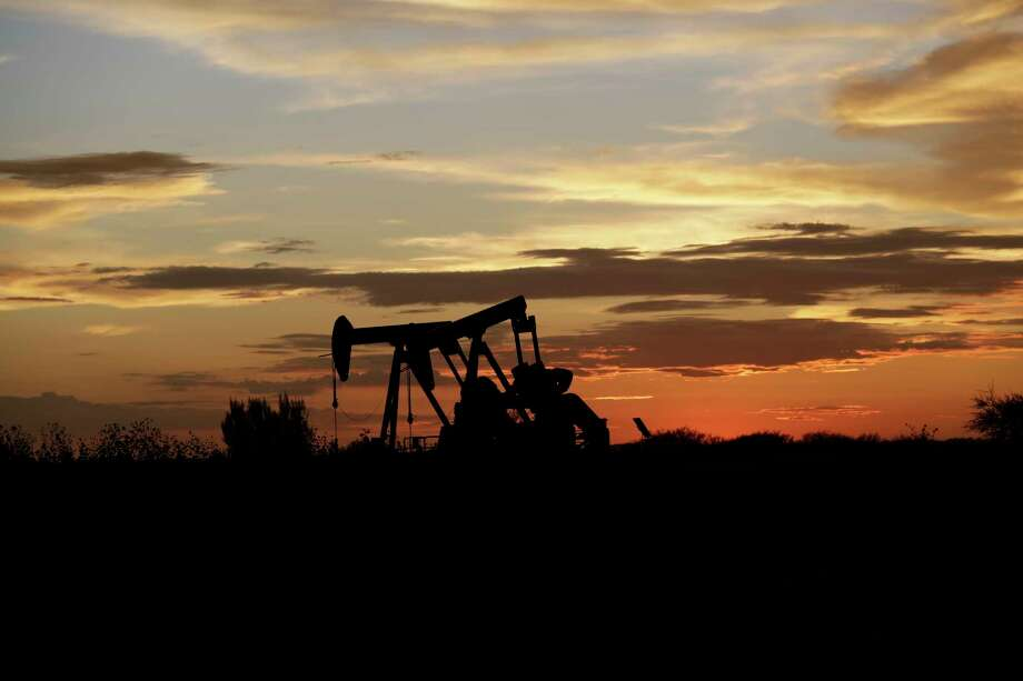 Pumpjacks work in an oil field at sunset after a thunderstorm passed through the area, Monday, June 5, 2017, in Karnes City, Texas. (AP Photo/Eric Gay) Photo: Eric Gay, STF / Copyright 2017 The Associated Press. All rights reserved.