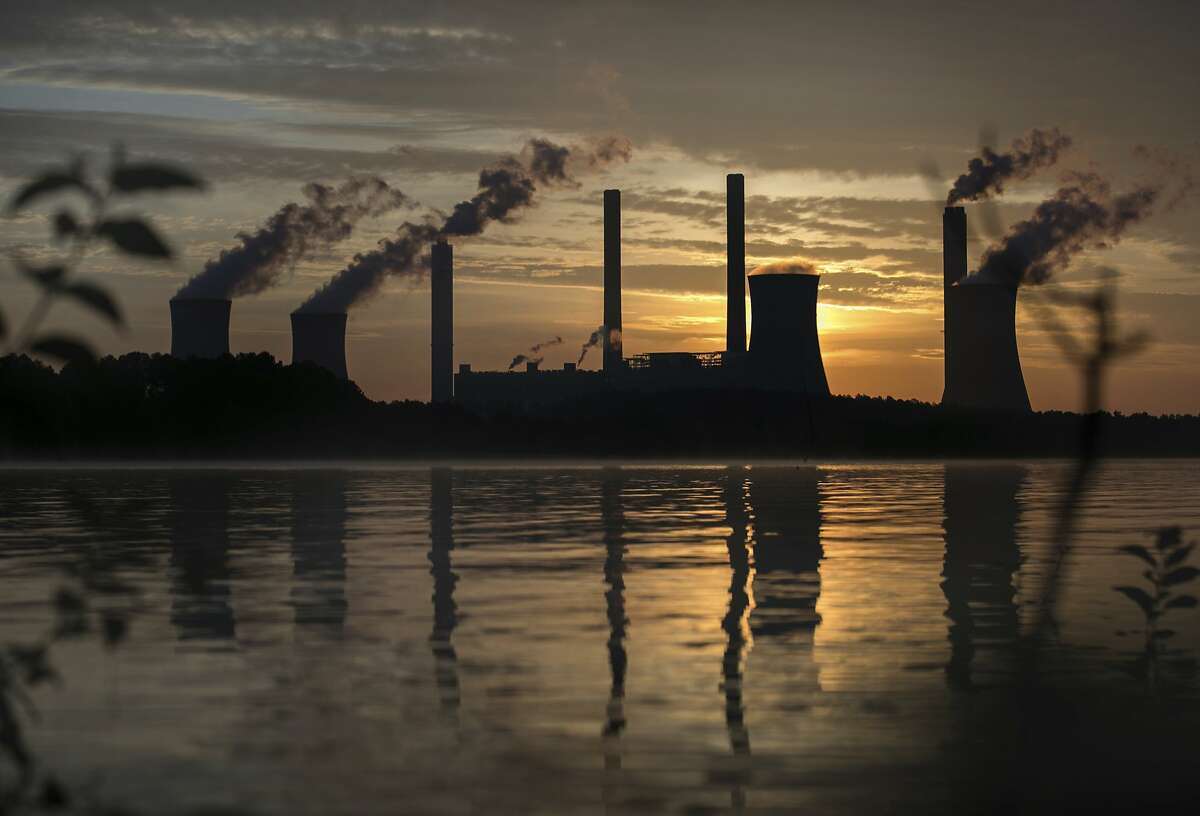 The coal-fired Plant Scherer, one of the nation's top carbon dioxide emitters, stands in the distance in Juliette. President Donald Trump pulled the U.S. from the landmark Paris climate agreement, striking a major blow to worldwide efforts to combat global warming and distancing the country from its closest allies abroad.